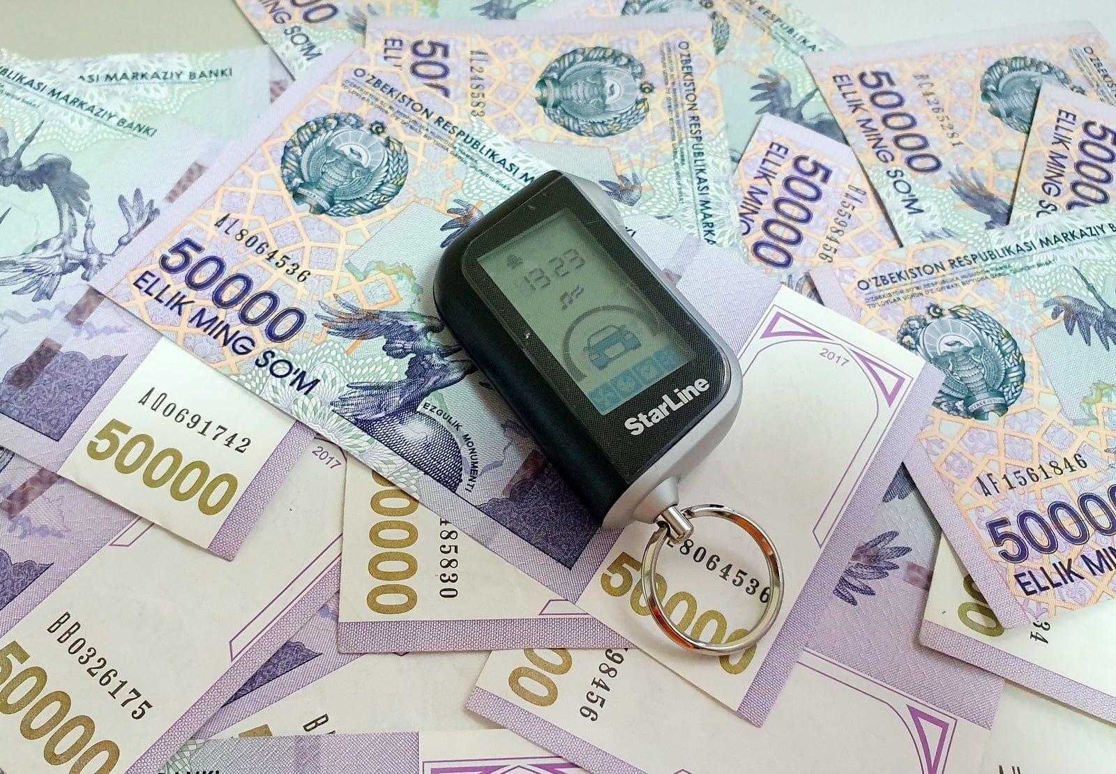 Узбекский сум - купюры номиналом 50 тысяч сумов. Базовая расчетная величина для штрафов и государственных пошлин в Узбекистане вводится вместо минималки МРЗП - теперь будет БРВ